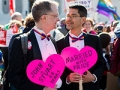 Married gay couple hold heart signs outside the U.S. Supreme Court on Tuesday, April 28, 2015.