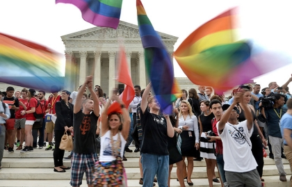 People celebrate outside the Supreme Court in Washington, DC on June 26, 2015 after its historic decision on gay marriage. The US Supreme Court ruled Friday that gay marriage is a nationwide right, a landmark decision in one of the most keenly awaited announcements in decades and sparking scenes of jubilation. The nation's highest court, in a narrow 5-4 decision, said the US Constitution requires all states to carry out and recognize marriage between people of the same sex.