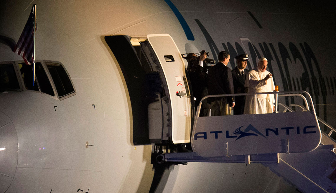 Pope Francis waves to the crowd at Philadelphia International Airport in Philadelphia as he departs for Rome on Sunday, Sept. 27, 2015.
