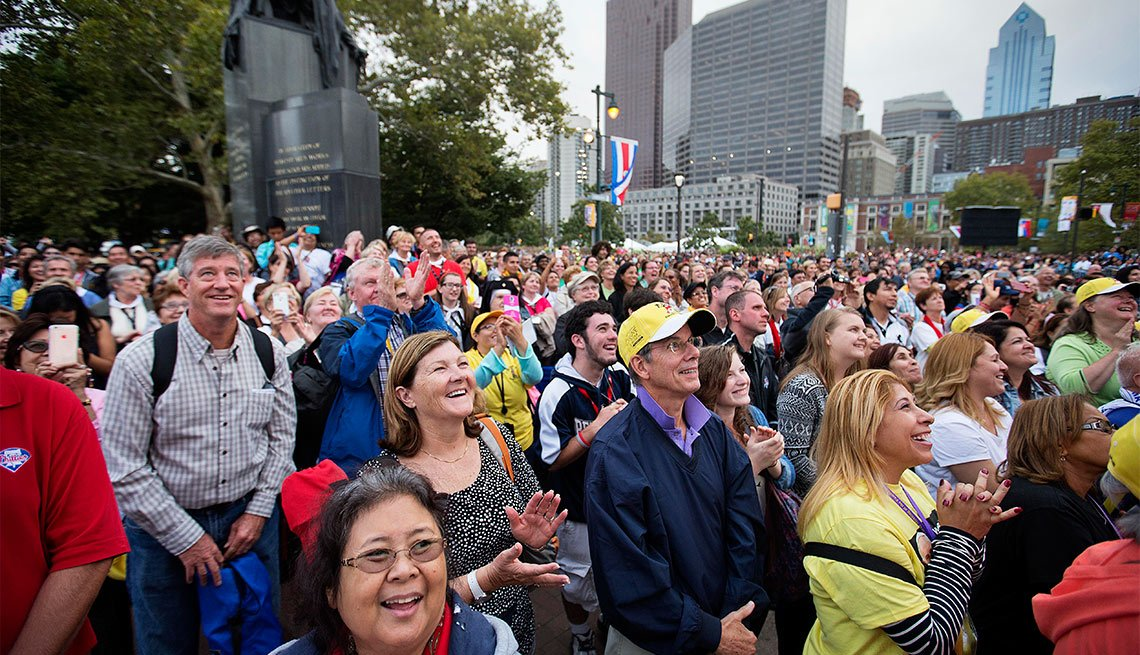 A crowd looks on as Pope Francis celebrates Mass Sunday, Sept. 27, 2015, in Philadelphia.