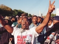 A man raises his hands in the air as he celebrates during Million Man March on the Mall, 16 October 1995, in Washington DC.