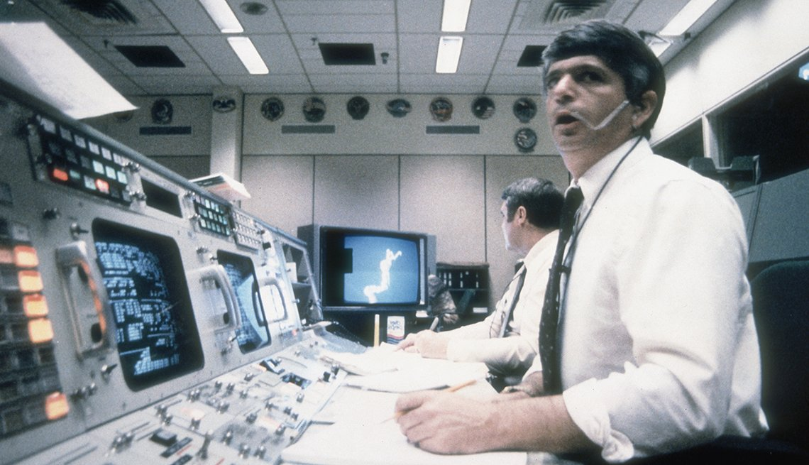 Frederick Gregory and Richard O. Covey, spacecraft communicators at Mission Control in Houston, watch helplessly as the shuttle Challenger explodes on Jan. 28, 1986.
