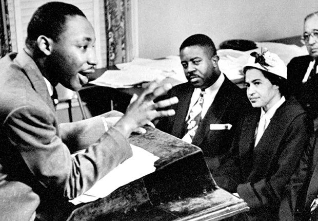 Rev. Martin Luther King outlines boycott strategies to his advisers & organizers incl. (seated L-R) Rev. Ralph Abernathy & Rosa Parks who was the catalyst for the protest of bus riders