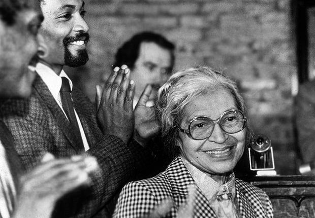 Civil rights leader Rosa Parks smiles while people gathered around her applaud at a ceremony held in her honor at the House of the Lord Church, Brooklyn, New York.