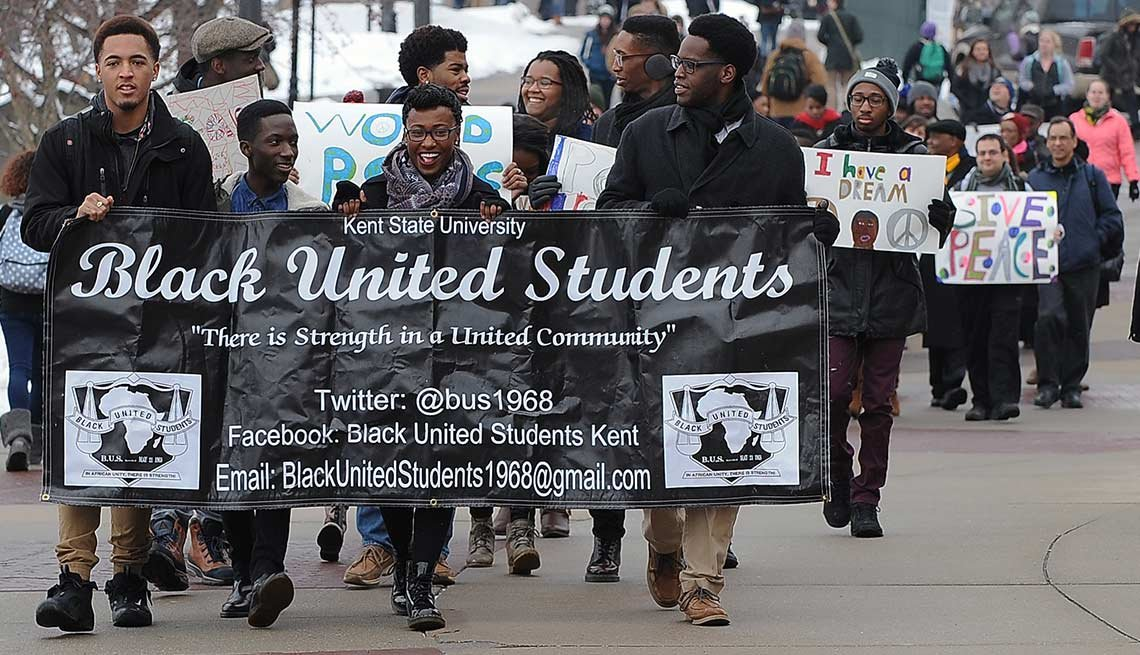 Kent State University students march toward the Kent Student Center along the Lefton Esplanade to a ceremony in honor of the legacy of Martin Luther King Jr.