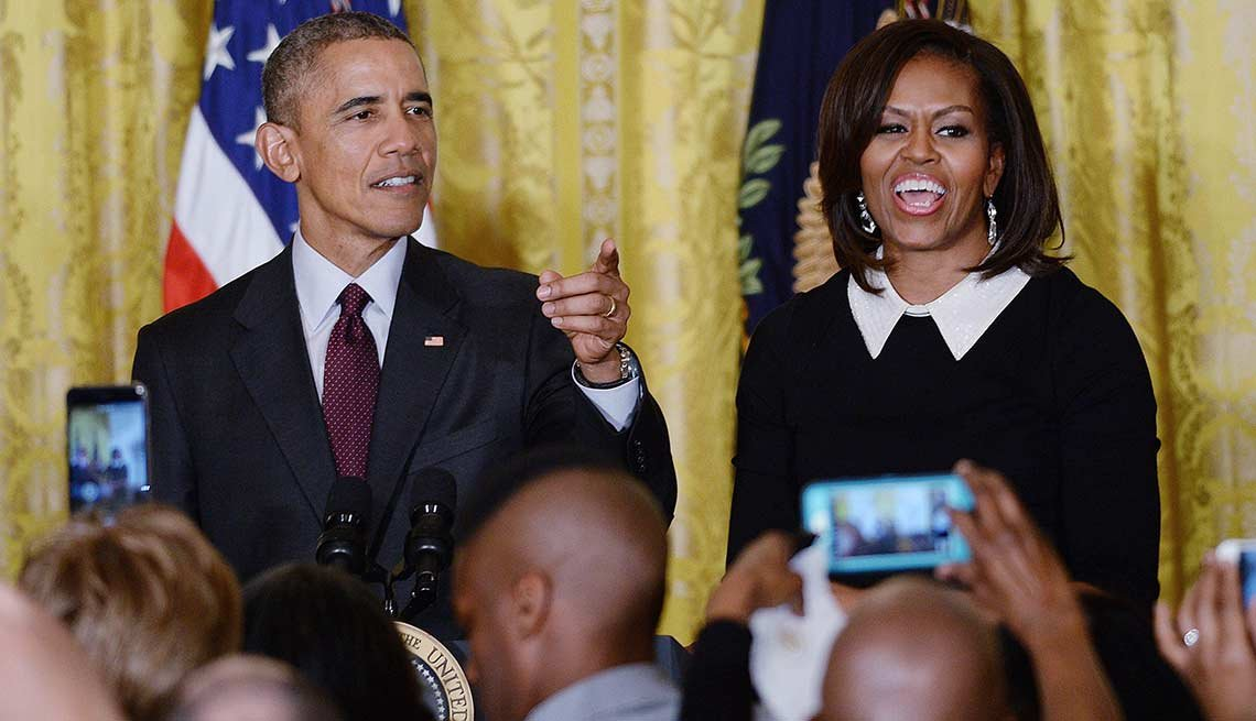 President Barack Obama (L) and First Lady Michelle Obama host a reception celebrating African American History Month