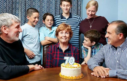 Boomers at 70, Kathleen Casey-Kirschling with birthday cake and family