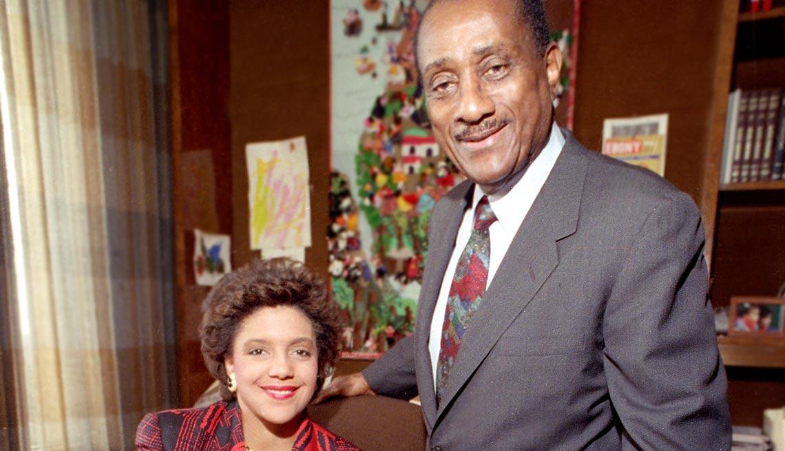 John H. Johnson, chairman and C.E.O. of Johnson Publishing Co., poses with his daughter Linda Johnson Rice