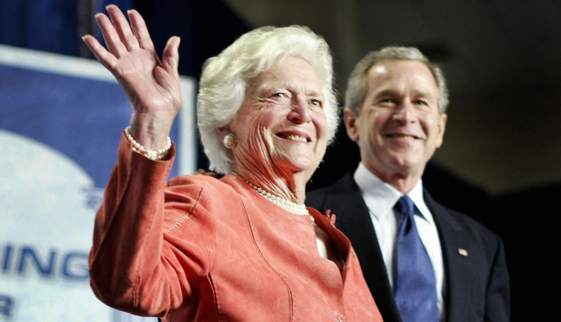 Barbara Bush waves after being introduced by her son US President George W. Bush