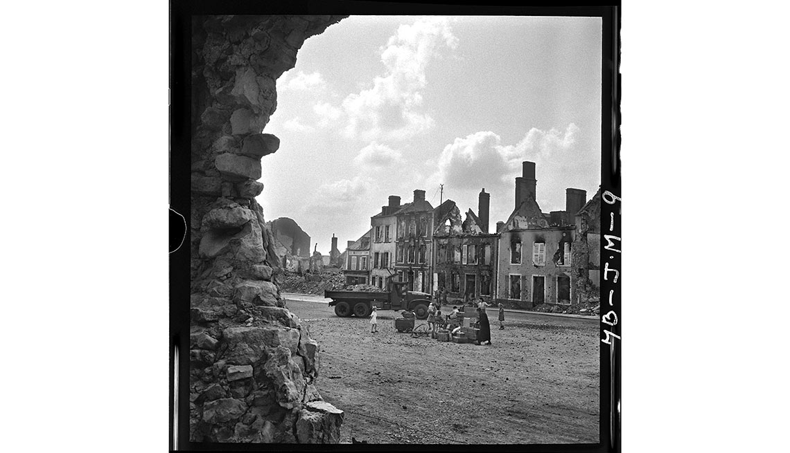 After D-Day, 'Somewhere in France' - Refugees gather in Montebourg, a town in Normandy, on July 24.