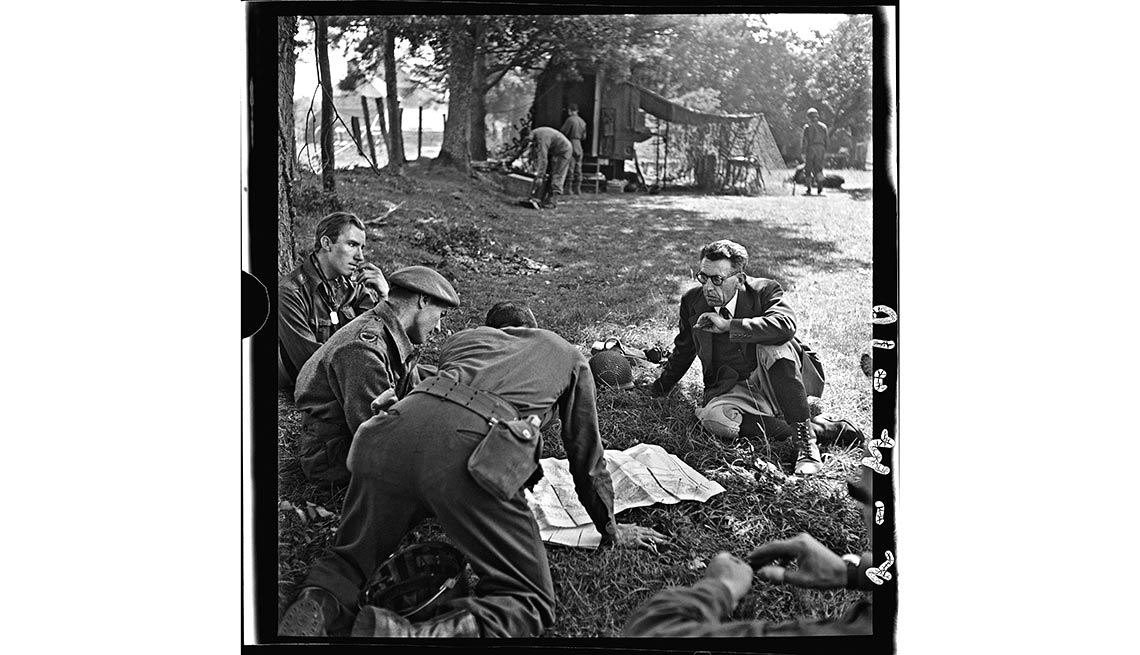 After D-Day, 'Somewhere in France' - British and Canadian war correspondents sit with a local official near the city of Saint-Malo in Brittany on Aug. 8.