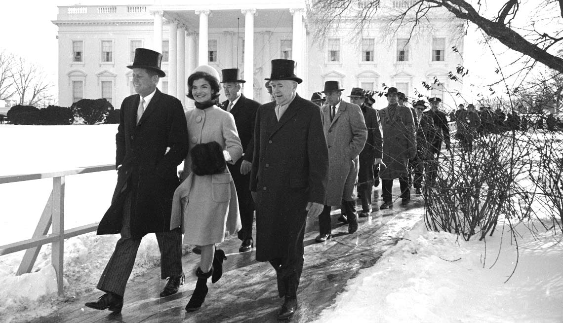 John Kennedy, Jacqueline and others walk from the White House on a frigid Inauguration Day.