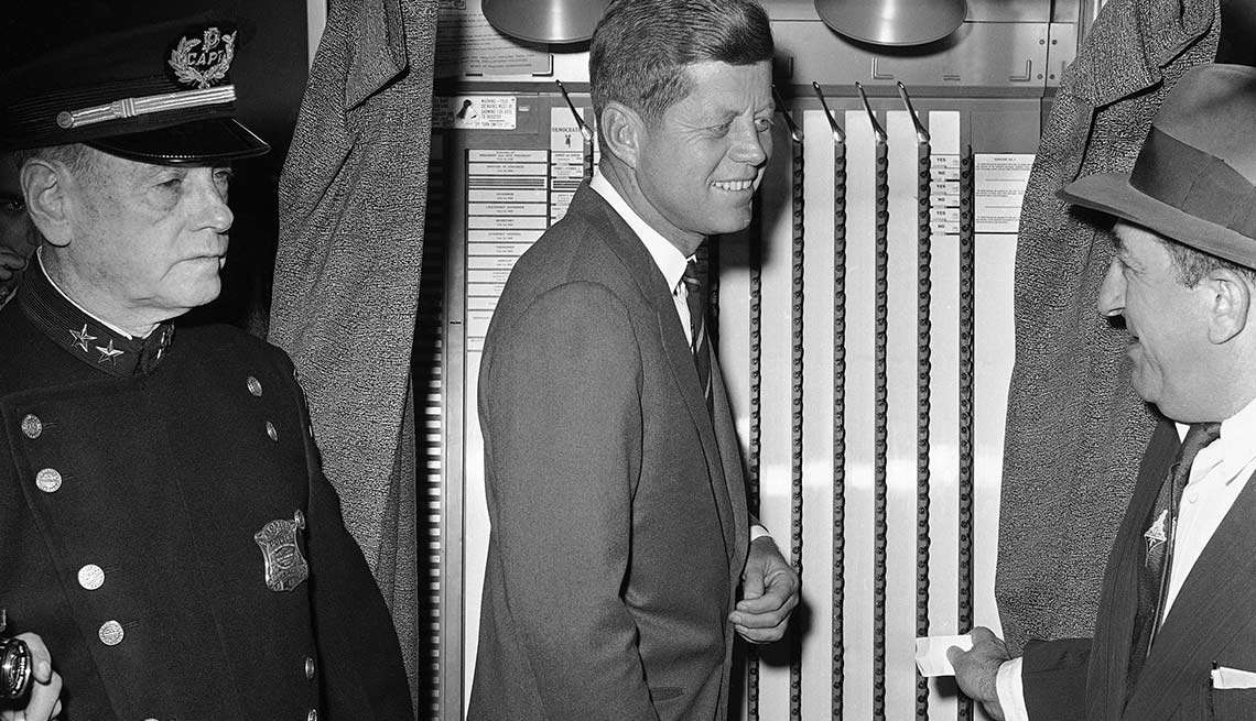 Kennedy joins approximately 67 million voters in casting a ballot on Nov. 8, 1960. The Democratic candidate, a native of Boston, voted in the West End branch library, Ward 3, Precinct 6.