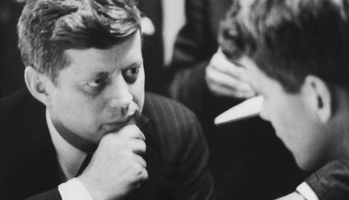 Back at campaign headquarters, Kennedy confers with his younger brother Robert, who he would later make his U.S. attorney general.