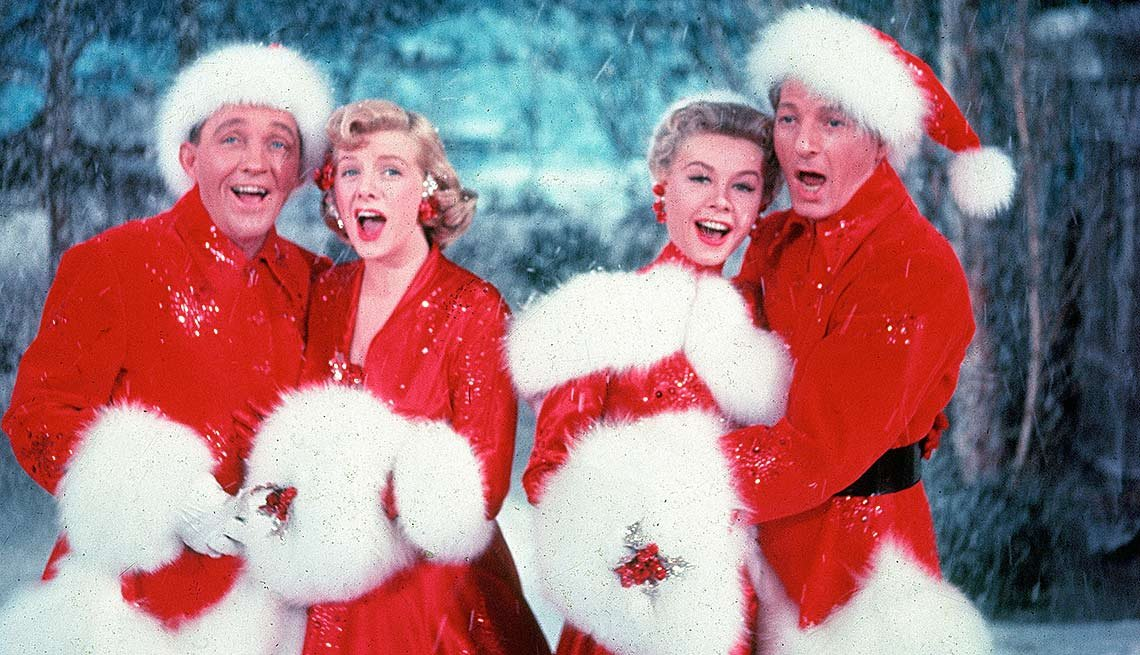 "Bing Cosby, Rosemary Clooney, Vera Ellen and Danny Kaye sing the Irving Berlin's song ""White Christmas"" in the movie"