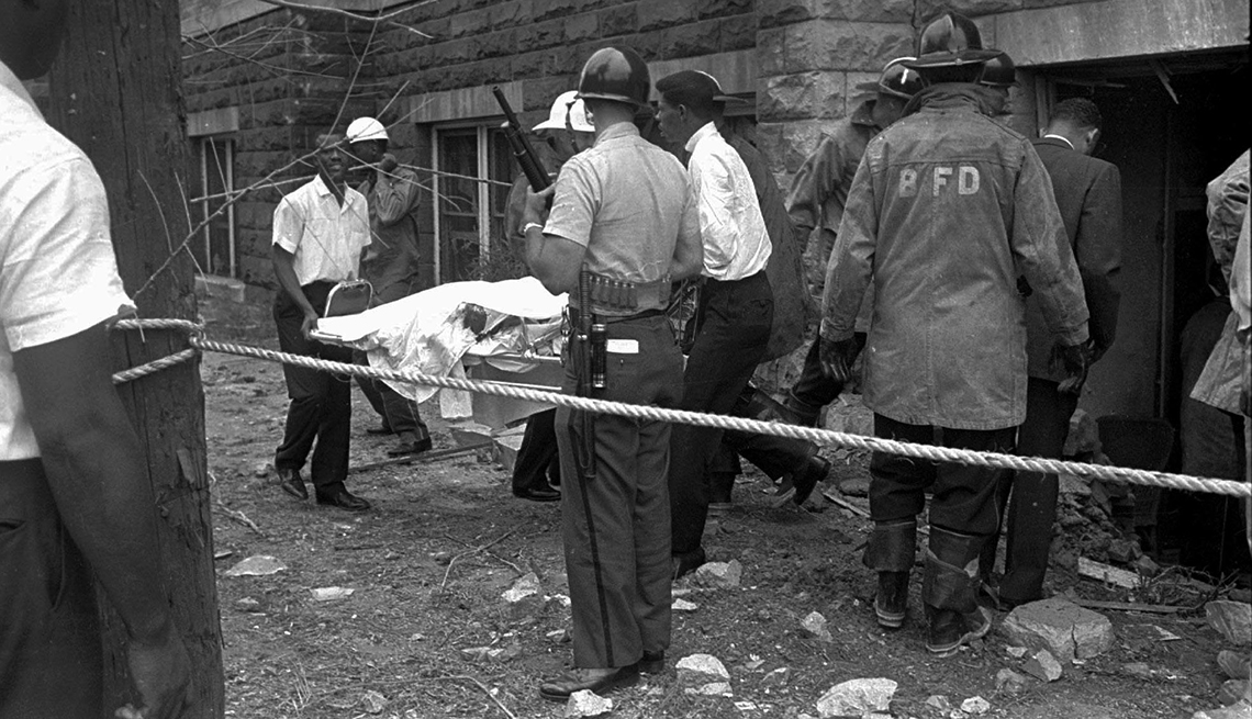 Bodies Are Carried Out Of Burned Building Amongst The Destruction In Birmingham Alabama, Civil Rights Movement, 1963 Was a Year With Lasting Impact, Violence In Birmingham, AARP Politics, Events And History