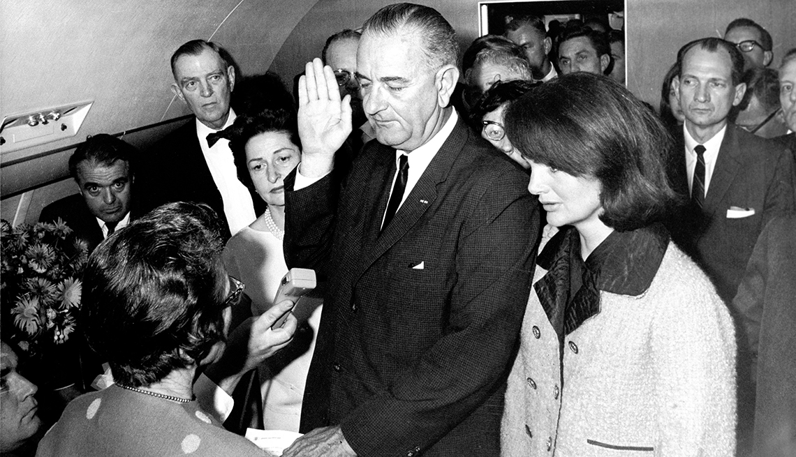 First Lady On Air Force One Stands By Lyndon B Johnson As He Is Sworn In As President After Kennedy's Assasination, Jackie O, First Lady, 1963 Was a Year With Lasting Impact, AARP Politics, Events And History