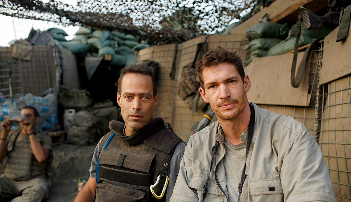 Writer Sebastian Junger (left) and photographer Tim Hetherington (right) during an assignment for Vanity Fair Magazine at 'Restrepo' outpost in the Korengal Valley, Afghanistan in 2007.