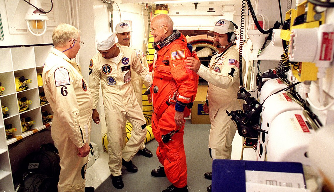 Astronaut Sen. John Glenn being prepared for his return to space mission aboard space shuttle Discovery