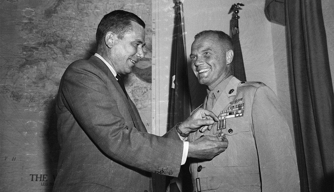 John Glenn receives Distinguished Flying Cross from Navy Secretary Thomas Gates for setting transcontinental speed record in Navy jet