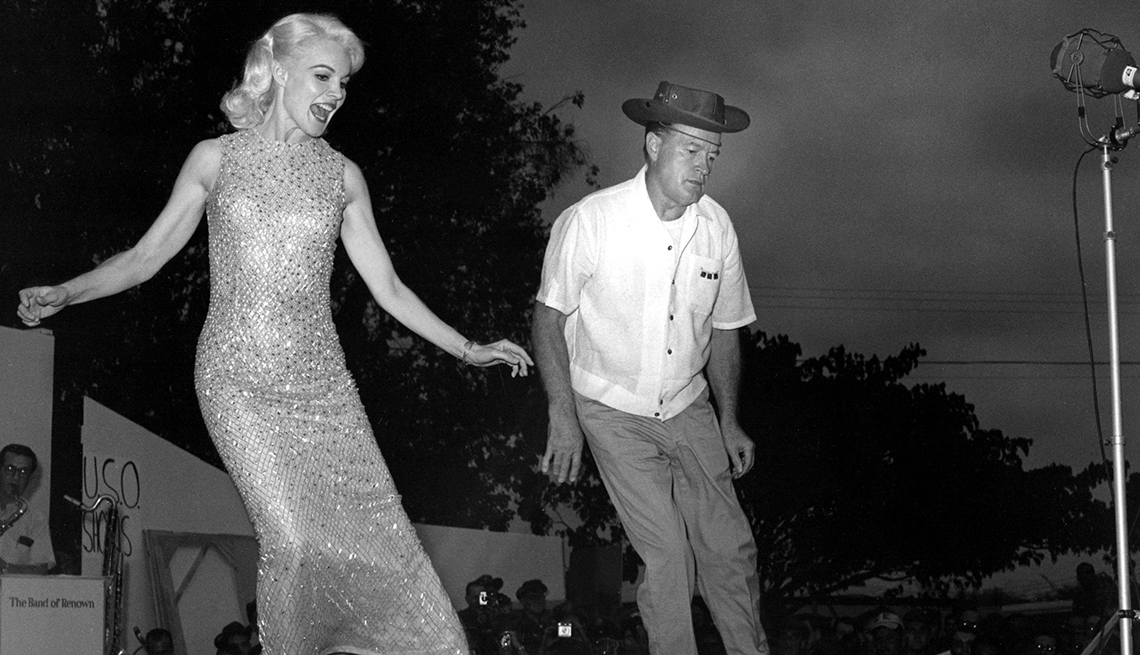 Carroll Baker, Bob Hope doing a dance routine while entertaining the troops in the Far East, 1965