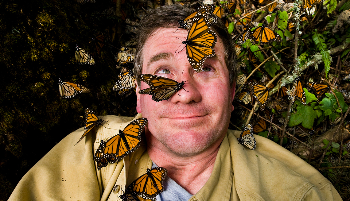Photographer Joel Satore is surrounded by butterflies in the Sierra Chincua monarch sanctuary.