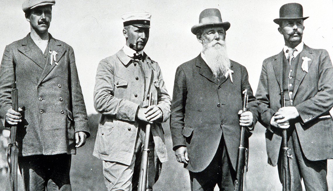 Oscar Swahn junto a otros competidores olímpicos