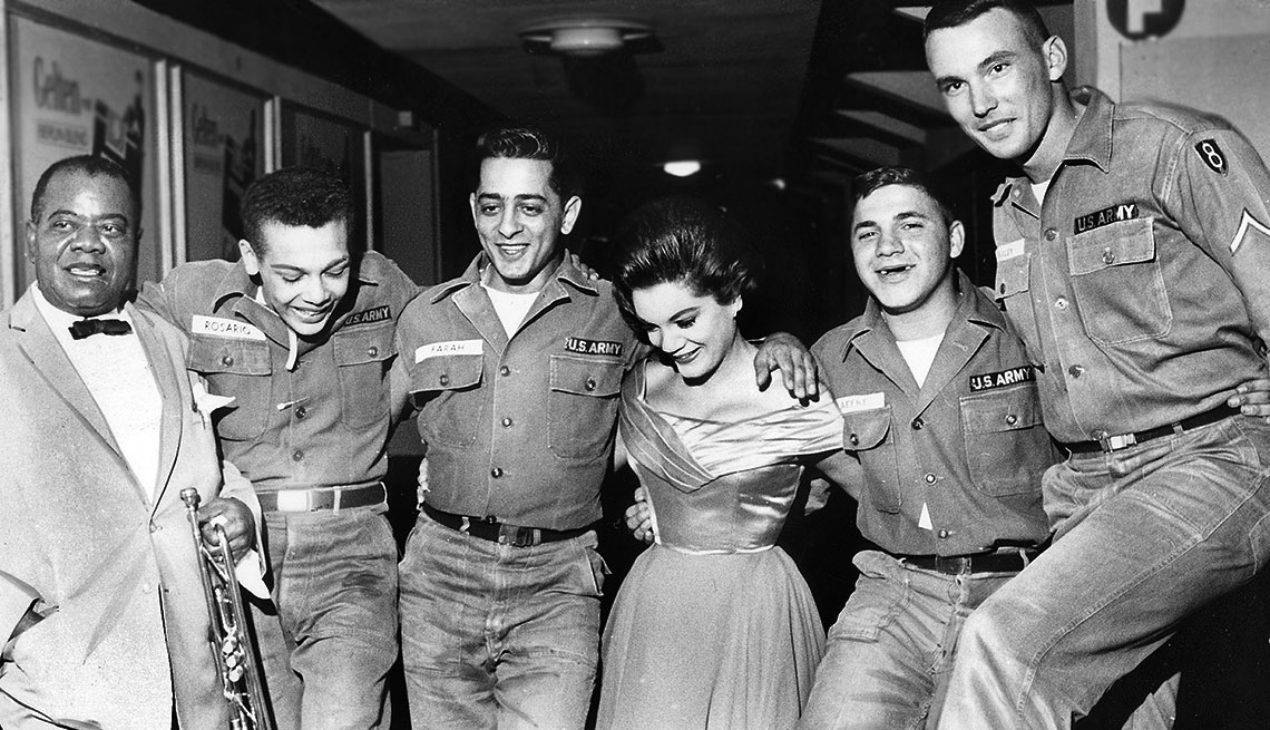 Louis Armstrong, Left, with Connie Francis and US solders  in Berlin's Sportpalast in 1962