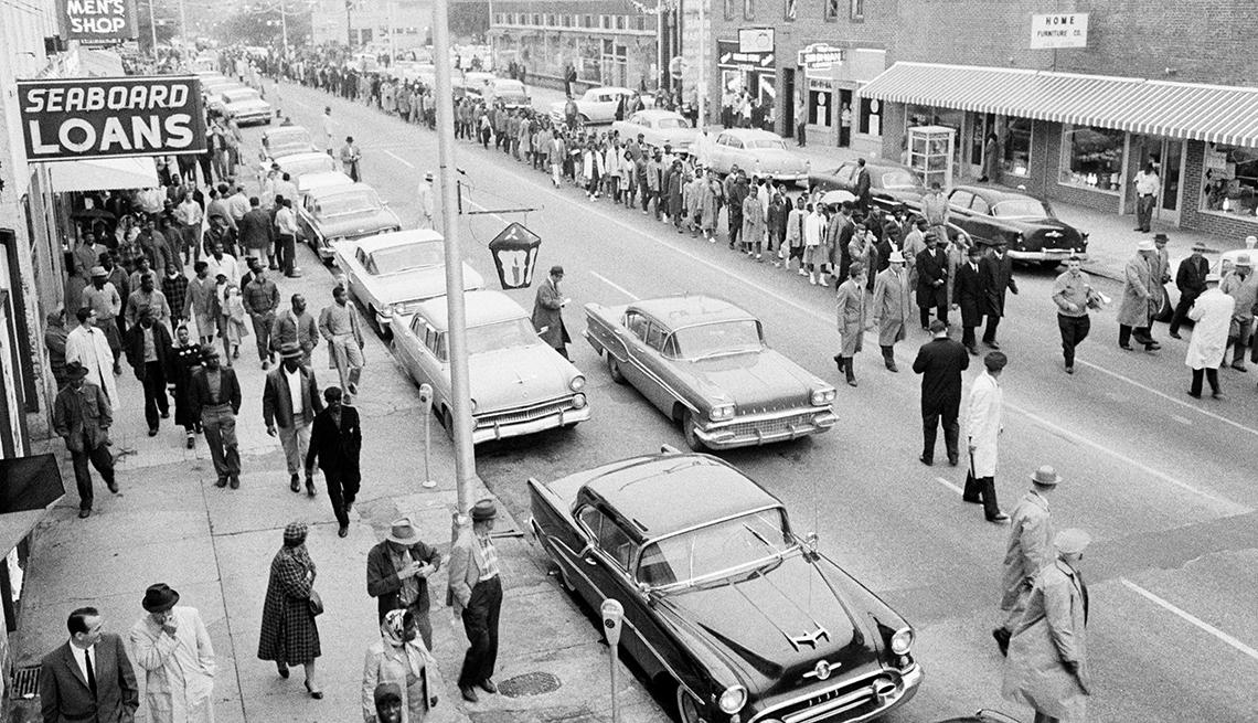 Martin Luther King, Jr. leads a line of African-American protesters down a street in Albany, Georgia