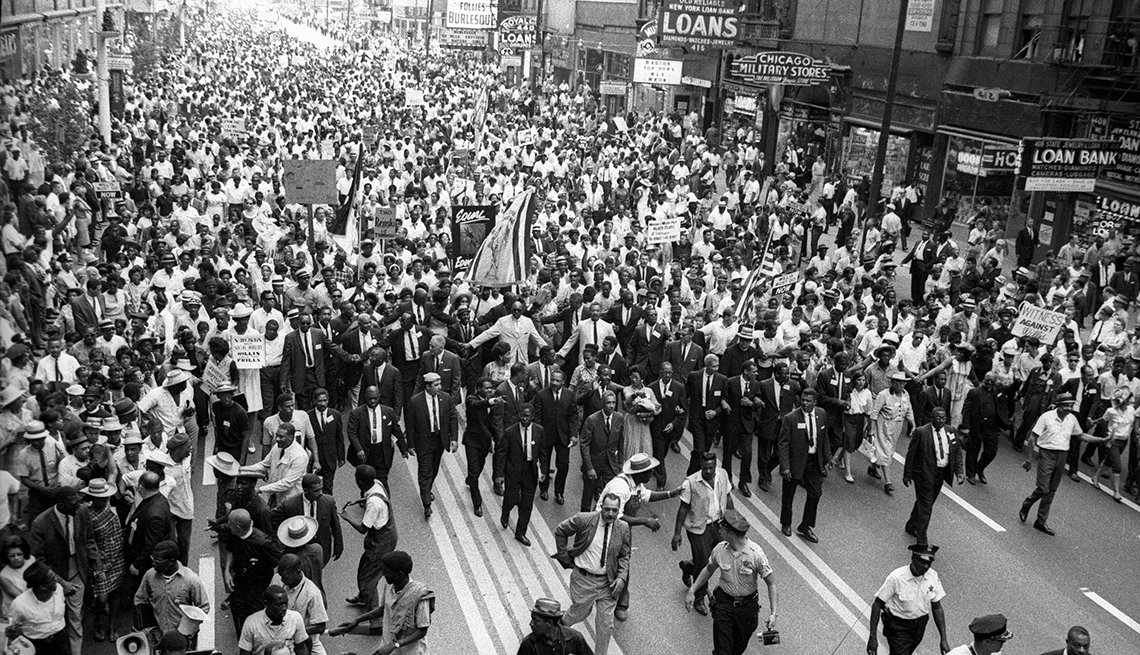 large group marches down city street with martin luther king in chicago