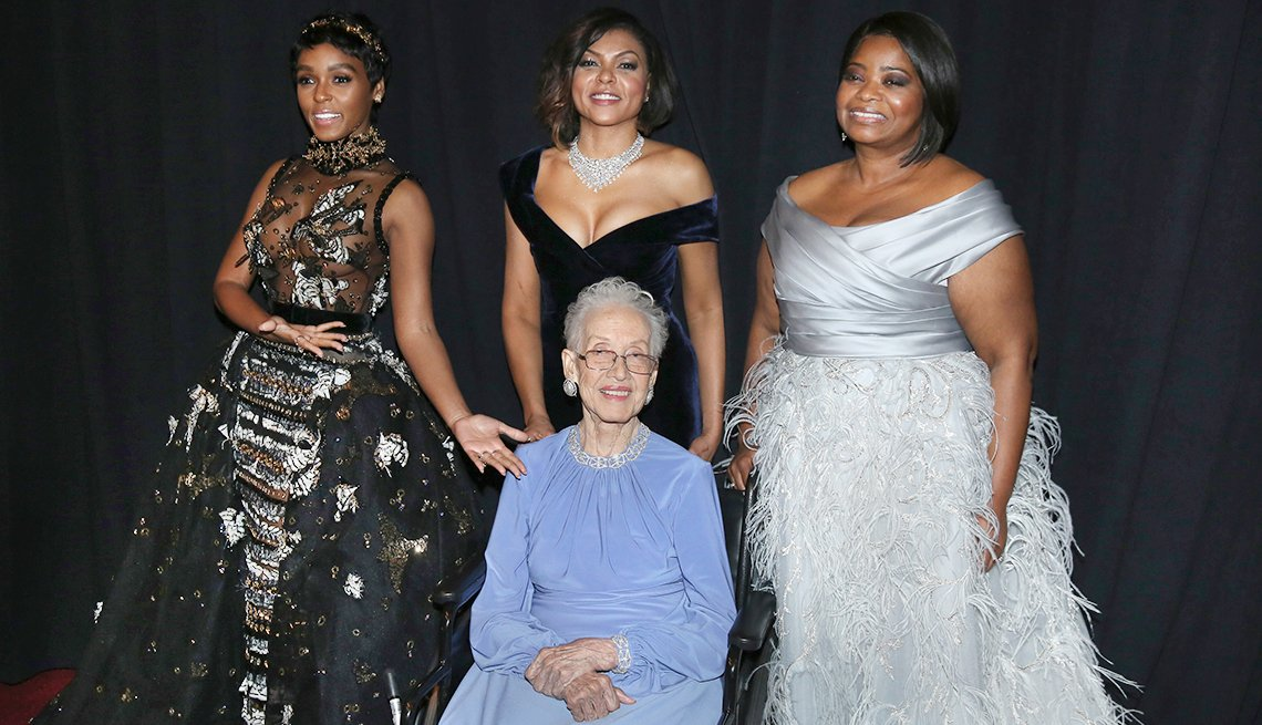 Janelle Monae, from left, Taraji P. Henson, and Octavia Spencer pose with Katherine Johnson, seated, backstage at the Oscars