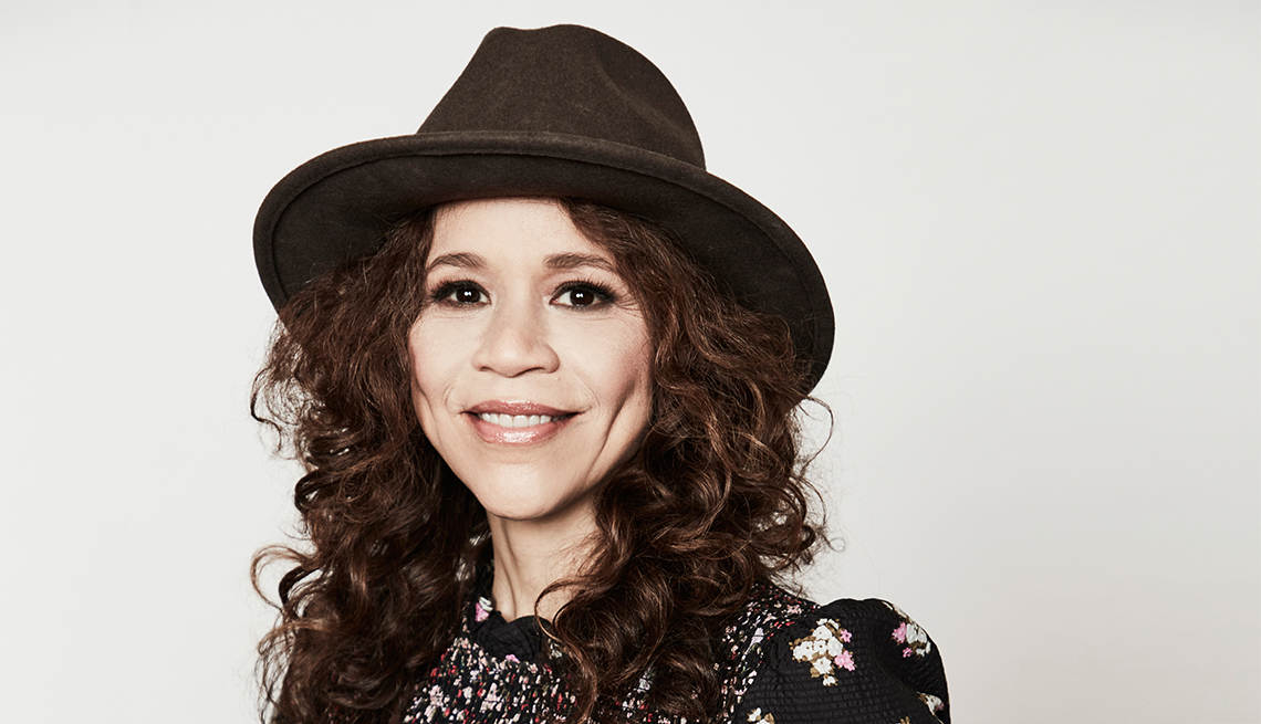 woman with curly hair wearing hat