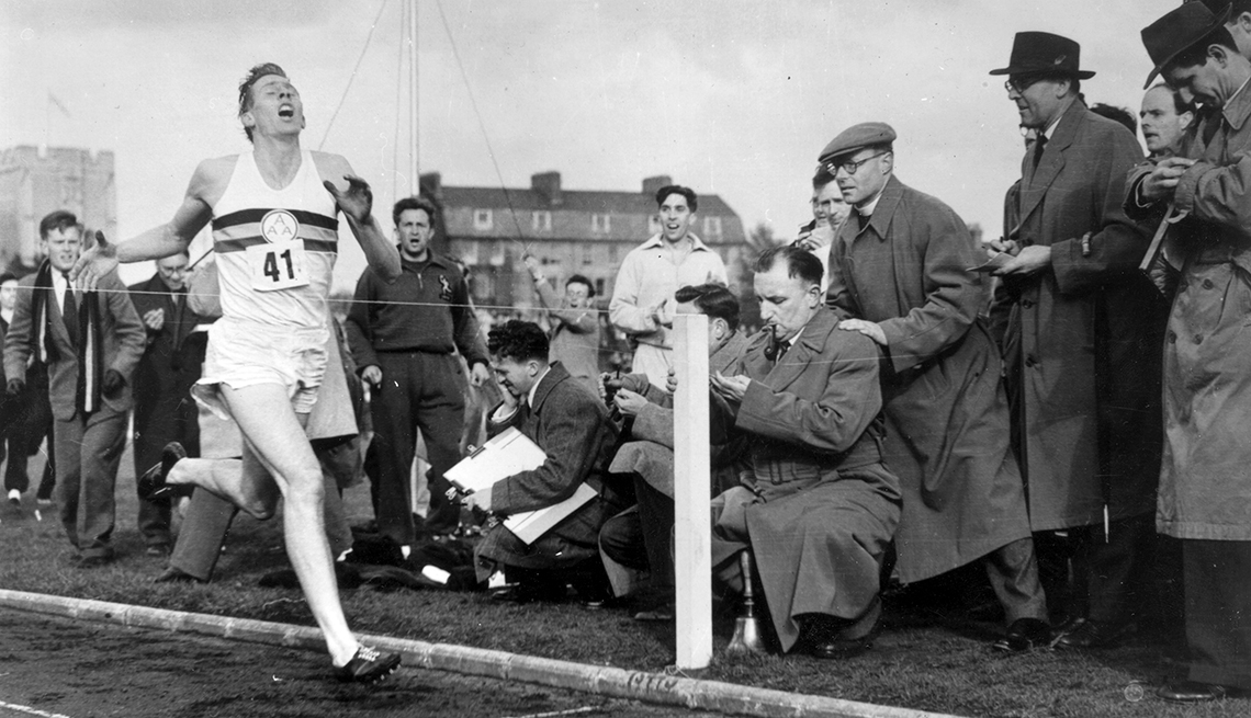 Roger Bannister crossing finish line in track race