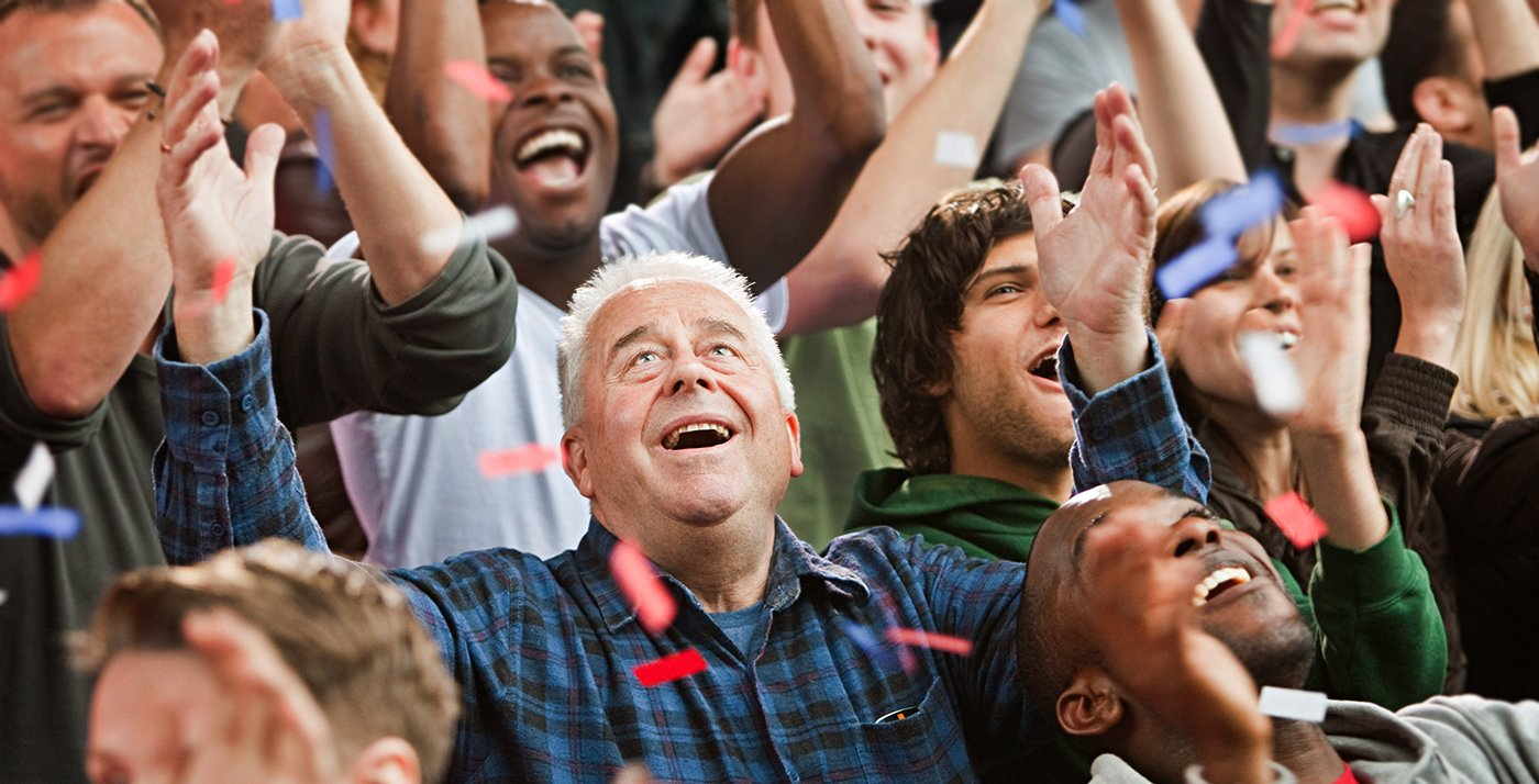 Mature adults cheer in a cowd