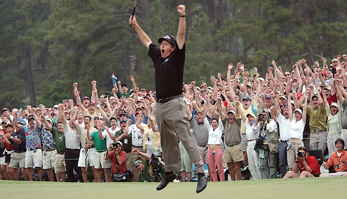 Phil Mickelson celebrates after winning the Masters golf tournament