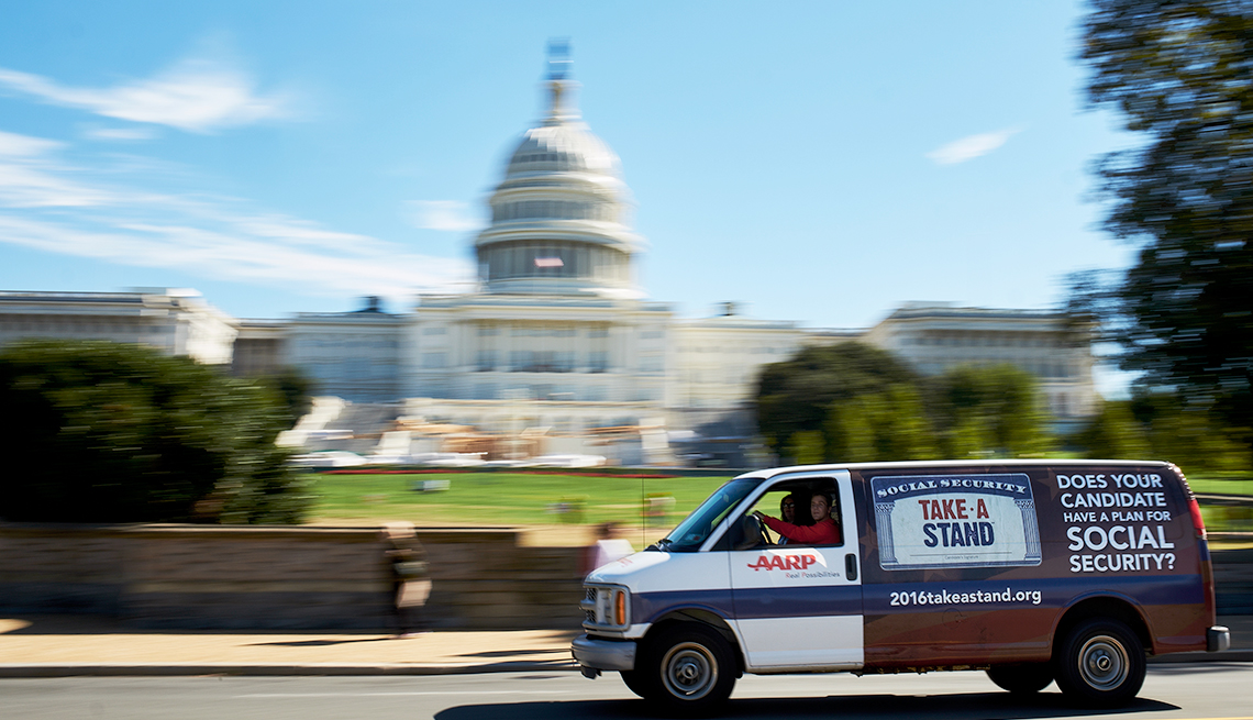 an AARP van drives past the U.S. Capitol building