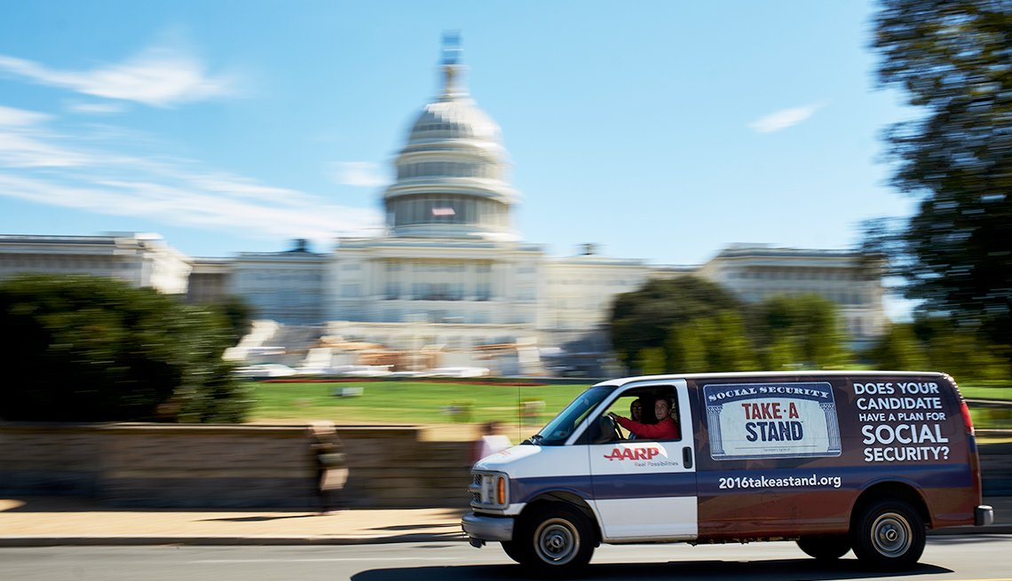 an AARP van drives past the U.S. Capitol building