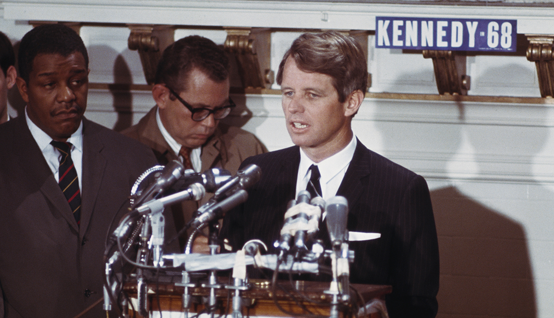 Robert Kennedy standing at a podium.