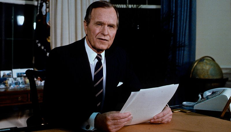 President George H.W. Bush in Oval office.