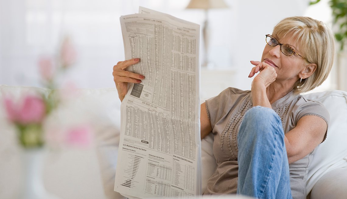Woman reading a newspaper