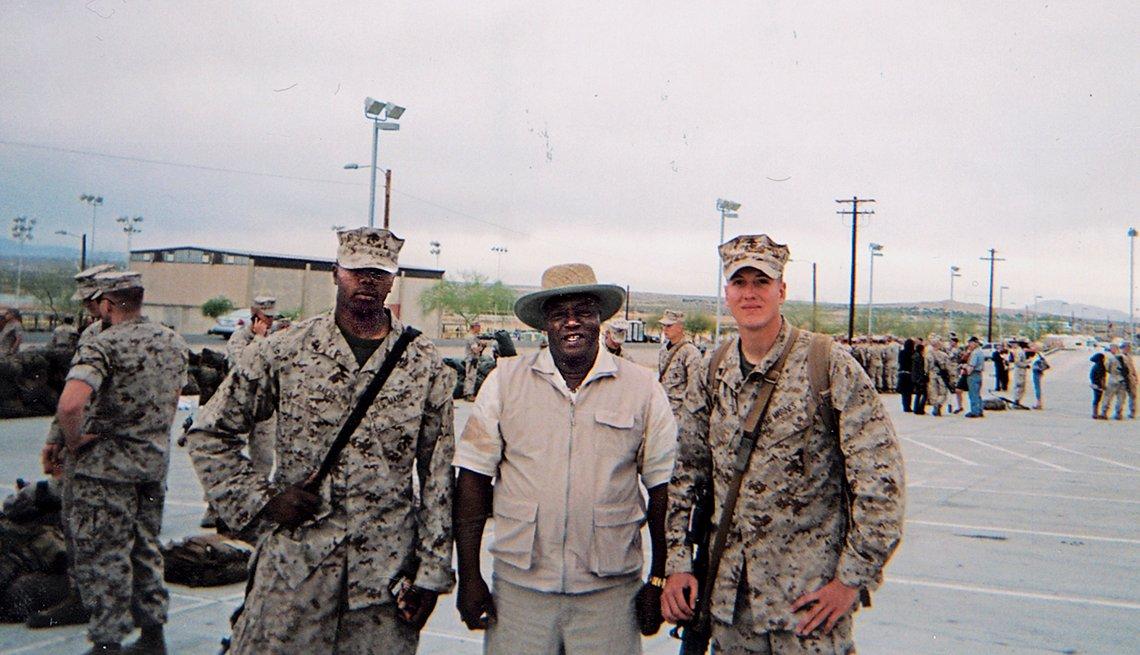 From left: Larry II, Larry Sr. and friend Garrett W. Bush on deployment day in 2011