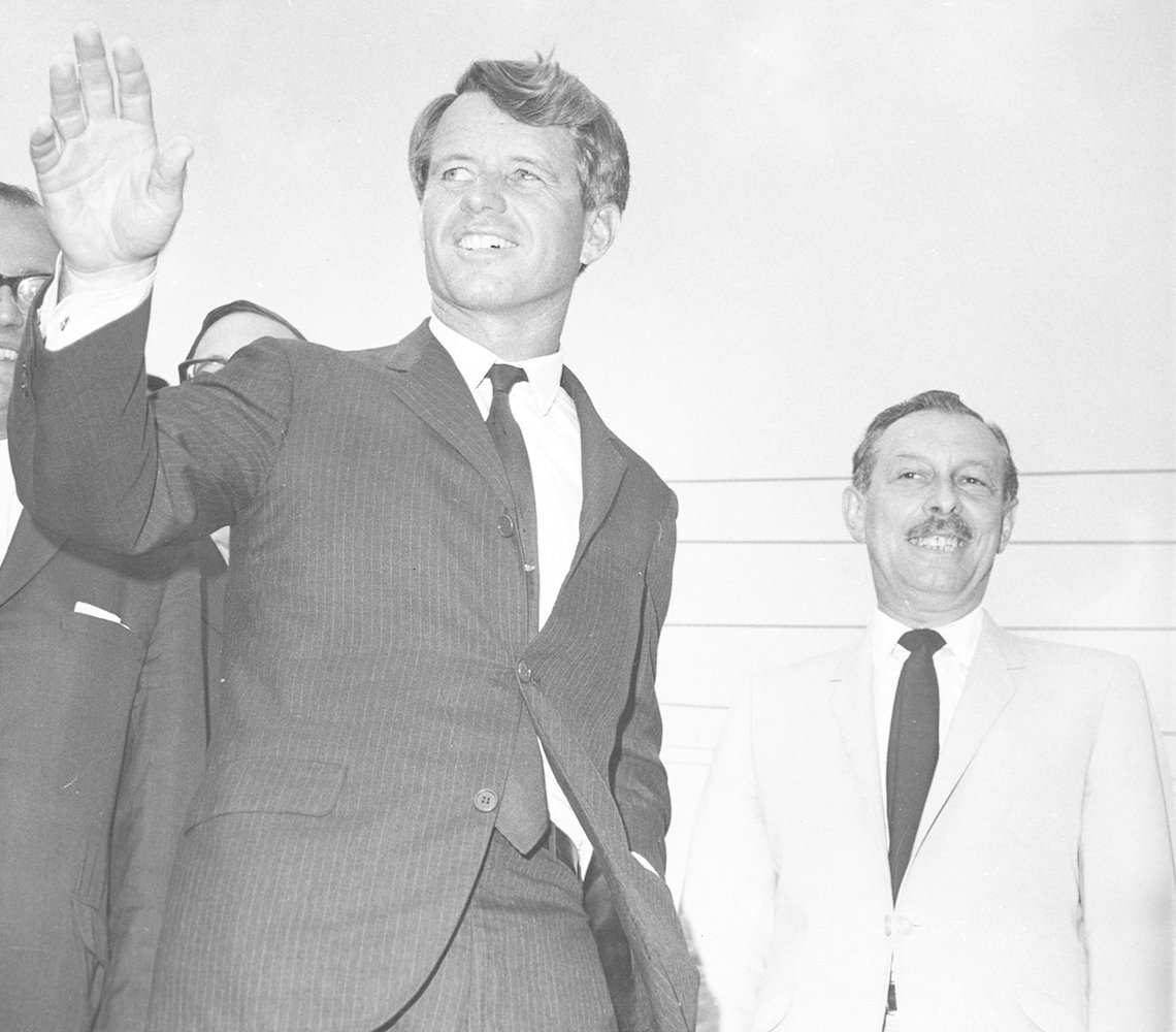 Robert Kennedy waves to a crowd while campaigning for Lester Wolff