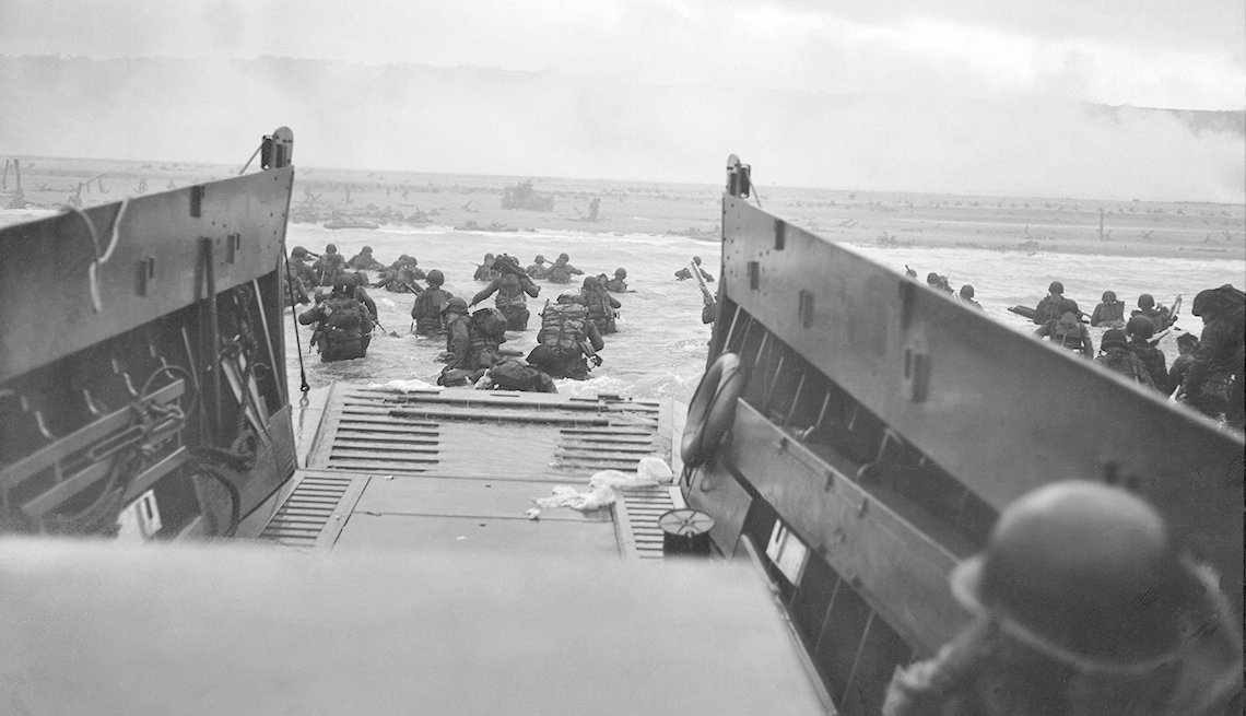 U S troops wading from landing craft towards Omaha Beach