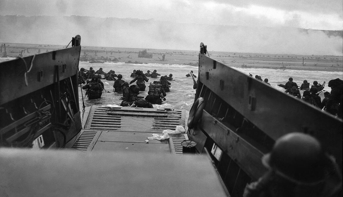 U S troops wading from landing craft towards Omaha Beach