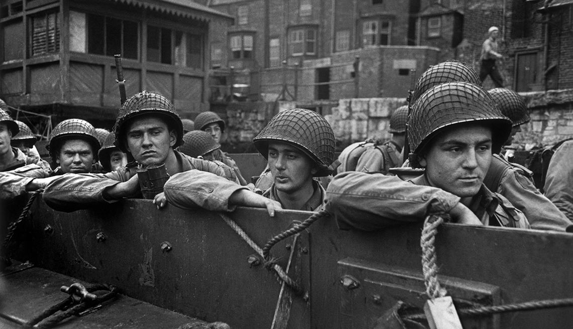 American troops being ferried to larger ships in preparation for the allied invasion of Normandy.