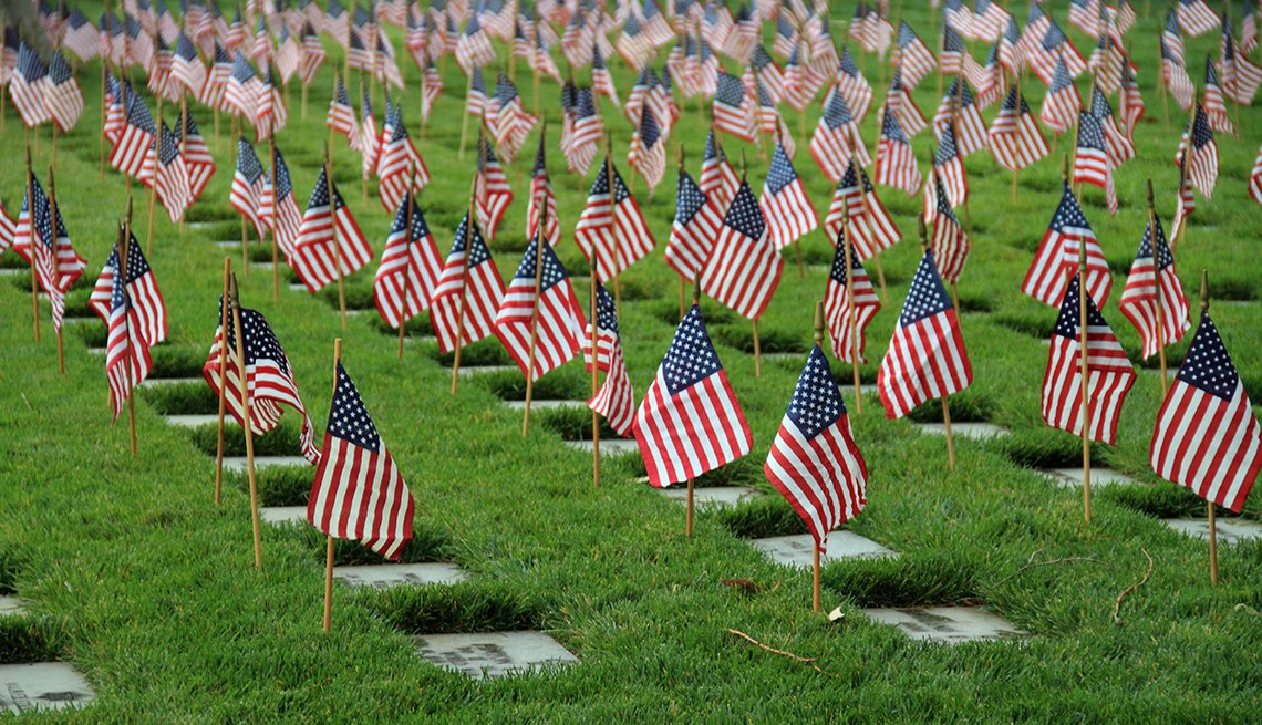 American flags stand at the grave markers