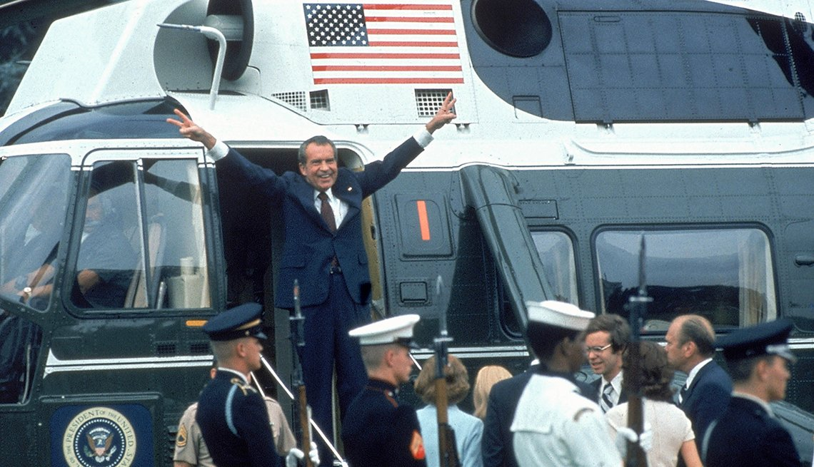 President Richard Nixon saluting the crowd after he resigns from office