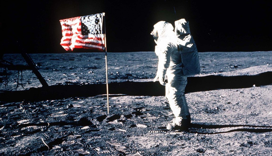Buzz Aldrin saluting the American flag on the moon