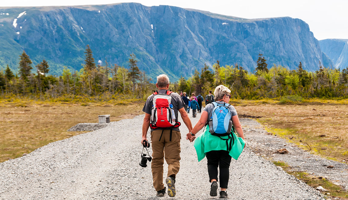 People walking along track to start of Western Brook Pond in Gros Morne National Park, Newfoundland