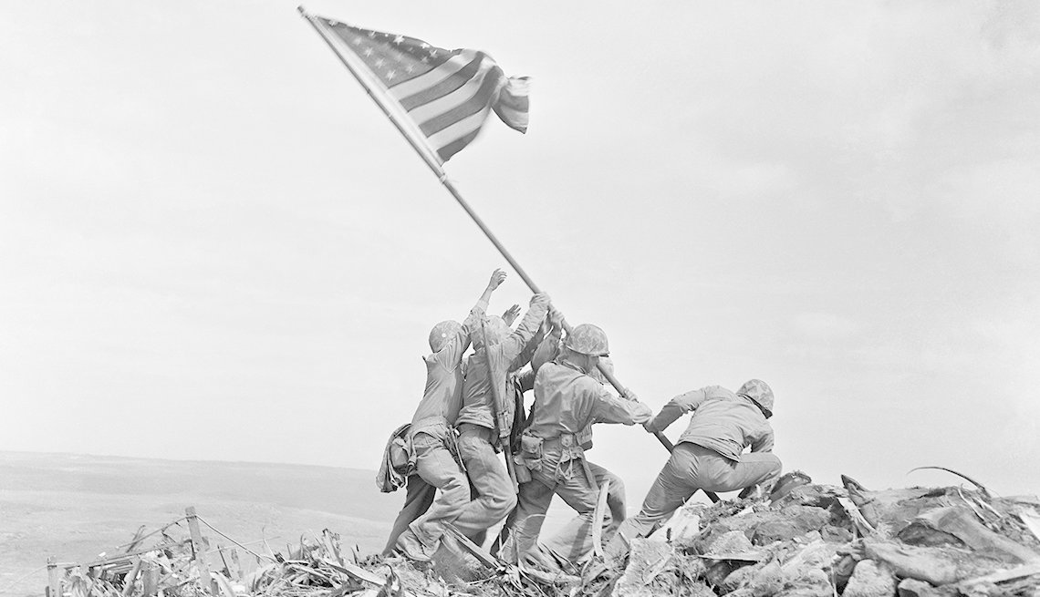 Marines raising an American flag during the battle of Iwo Jima